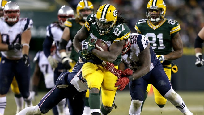 Green Bay Packers' Eddie Lacy runs for a first down in the fourth quarter.  The Green Bay Packers host the New England Patriots Sunday, November 30, 2014, at Lambeau Field in Green Bay, Wis.  Wm.Glasheen/P-C Media