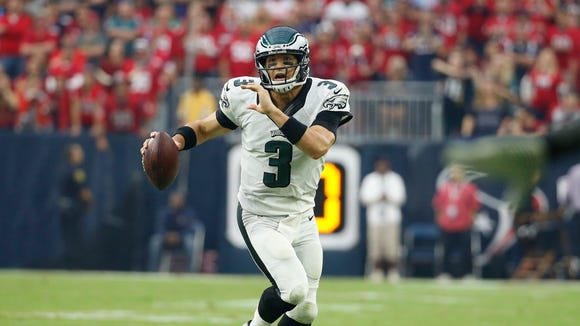 Eagles quarterback Mark Sanchez scrambles during the fourth quarter of Sunday's game.