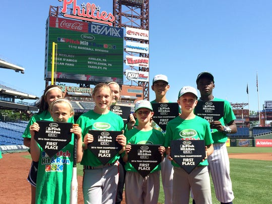 Lebanon's Tyler Reinhart, 8, stands with his fellow winners at the Scotts Major League Baseball Pitch, Hit & Run Team Championship competition held at Citizens Bank Park in Philadelphia on June 18.