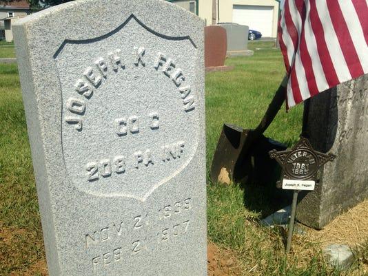 ldn-mm-070916-gravestone