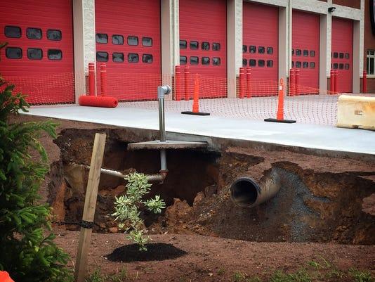 1-ldn-mm-053017-sink-hole-fire-01.jpg