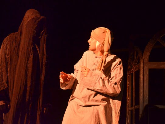 Ebenezer Scrooge is confronted by the Ghost of Christmas