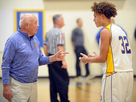 Wi-Hi coach Butch Waller talks to John Taylor during