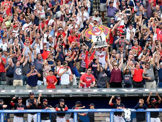 Cleveland Indians fans celebrate after a 5-3 Indians