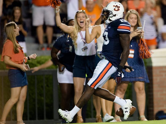 Auburn defensive back Javaris Davis (13) returns an interception for a touchdown during the NCAA football game between Auburn and Mississippi State on Saturday, Sept. 30, 2017 in Auburn, Ala.