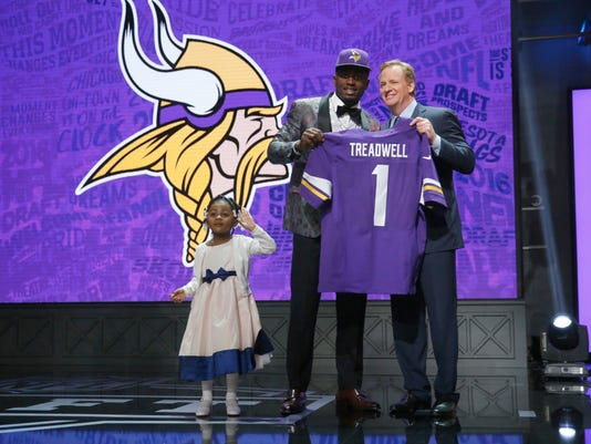Mississippi's Laquon Treadwell poses for photos with NFL Commissioner Roger Goodell and his daughter Madison after being selected by Minnesota Vikings as the 23rd pick in the first round of the 2016 NFL football draft, Thursday, April 28, 2016, in Chicago. (AP Photo/Charles Rex Arbogast)