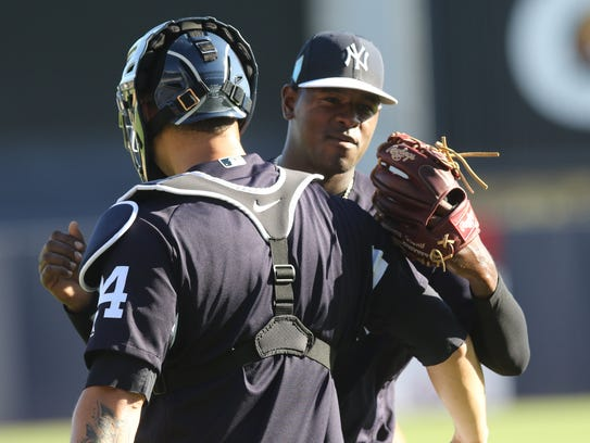 Catcher, Gary Sanchez hugs pitcher Luis Severino after