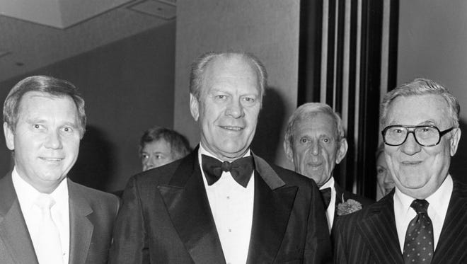 President Gerald Ford and unidentified men.