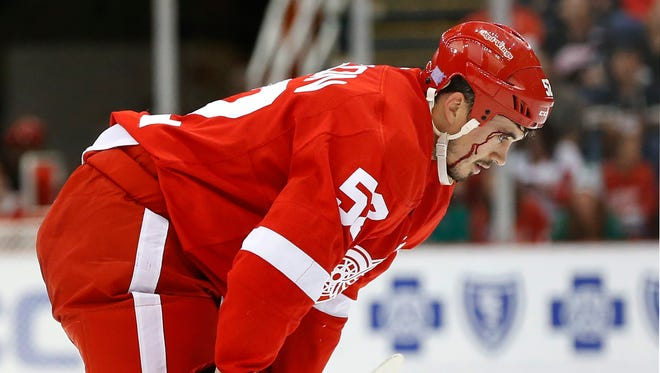 Detroit Red Wings defenseman Jonathan Ericsson leaves the ice with blood flowing down his face against the Dallas Stars on Sunday, Nov. 8, 2015, in Detroit.