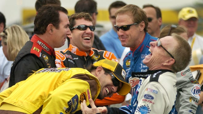 Elliott Sadler (in yellow), Mike Bliss, Tony Stewart, Rusty Wallace and Mark Martin (from bottom left) share a laugh before driver introductions for the 2005 Cup race at Watkins Glen International.