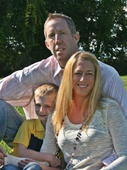 Nate Huffman, with his wife Michelle and his son Christian.