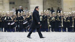 French President Francois Hollande arrives to lead