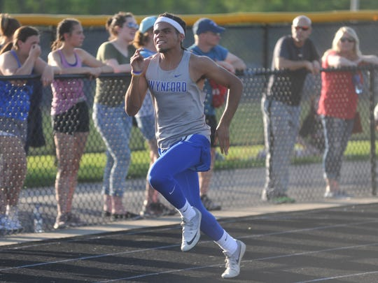 Wynford's Alizhah Watson races in the 400 dash at the regional meet.