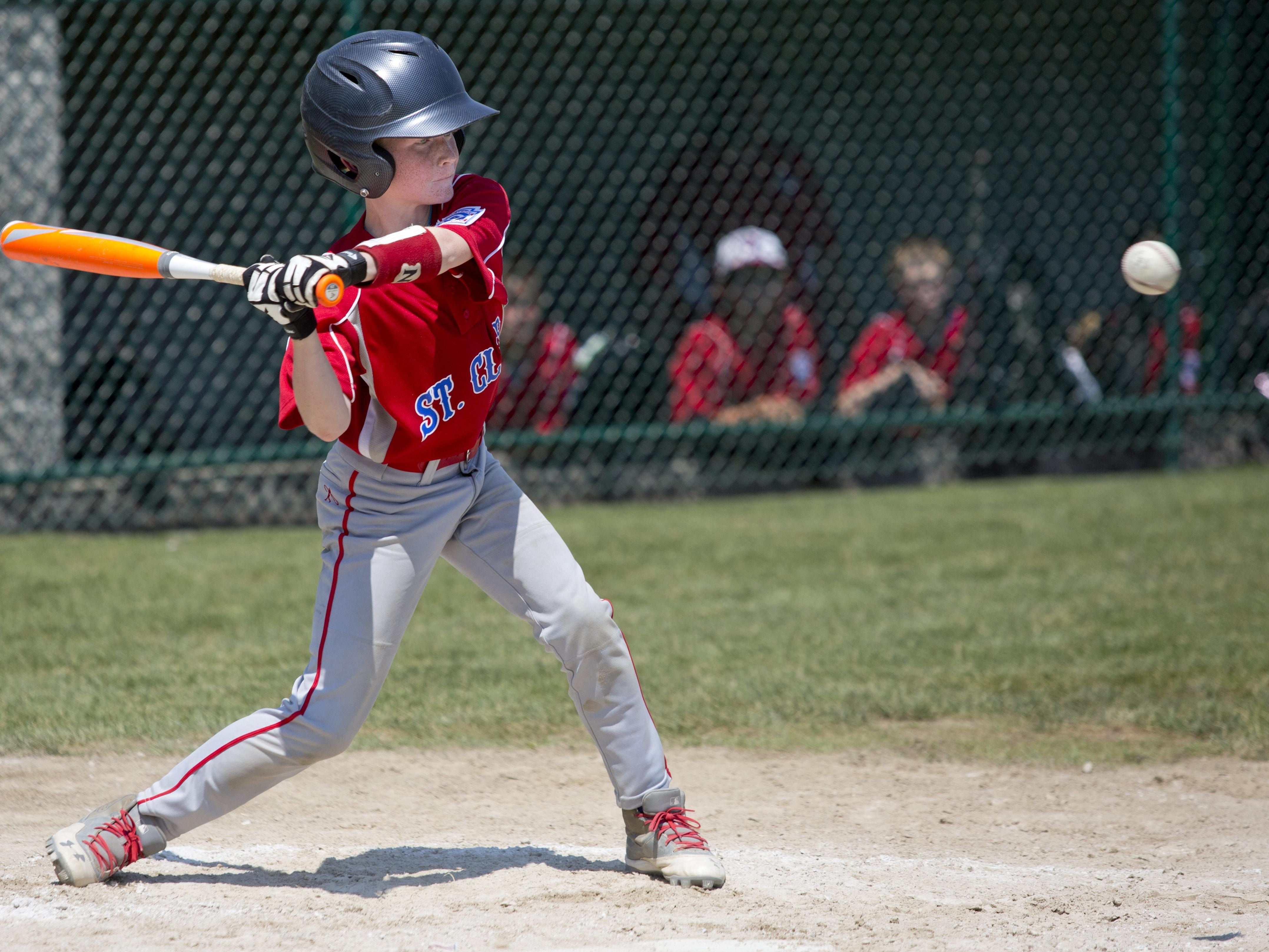 Carter Boullard gets a hit during a 10-and-under state semifinal baseball game Tuesday, July 28, 2015 in St. Clair.