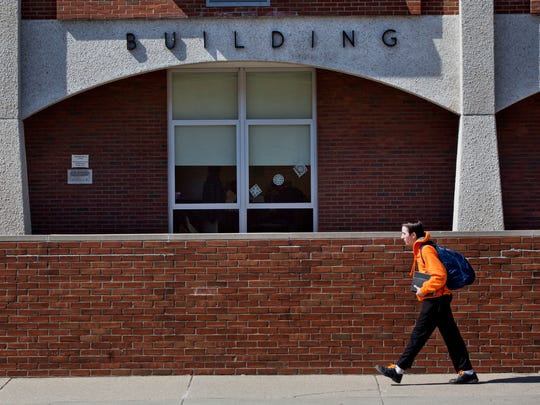 Students walk to class Tuesday, March 24, 2015 at St. Clair County Community College in Port Huron. The SC4 Board of Trustees recently approved increasing tuition rates by approximately 3 percent.