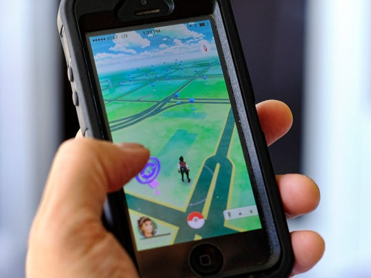 Pokémon Go is displayed on a cellphone. Just days after being made available in the U.S., the mobile game Pokémon Go has jumped to become the top-grossing app in the App Store.