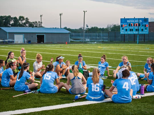 South Burlington field hockey coach Anjie Soucy speaks to her players at halftime during their match against Mt. Mansfield in South Burlington on Wednesday, September 27, 2017.