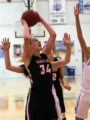 Sacred Heart Academy's Grace Berger (34) fights to