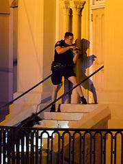 Charleston police officers search for a shooting suspect