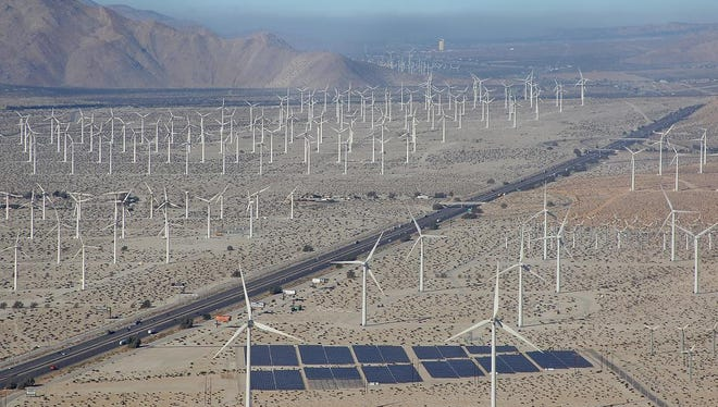 Wind turbines and solar panels dominate the landscape along Interstate 10 near Palm Springs on Oct. 20, 2014.