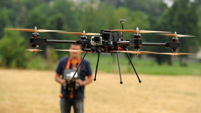 A man operates a remote control 4-8X Dual Atex drone on June 6, 2015, in Pau, southwestern France.