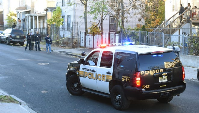 Police officers at the scene of the Nov. 18 shooting on Godwin Avenue in Paterson.