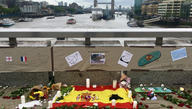 Floral tributes to Spanish national Ignacio Echeverria, 39, lay on London Bridge in London. Facebook said Thursday it's cracking down on terrorist activity on its platform.