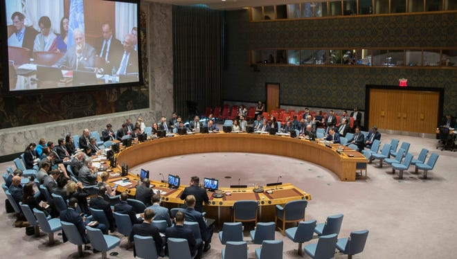 United Nations special envoy to Syria Staffan de Mistura is seen on a video screen as he listens to a Security council meeting on Syria at U.N. headquarters in New York on June 27.