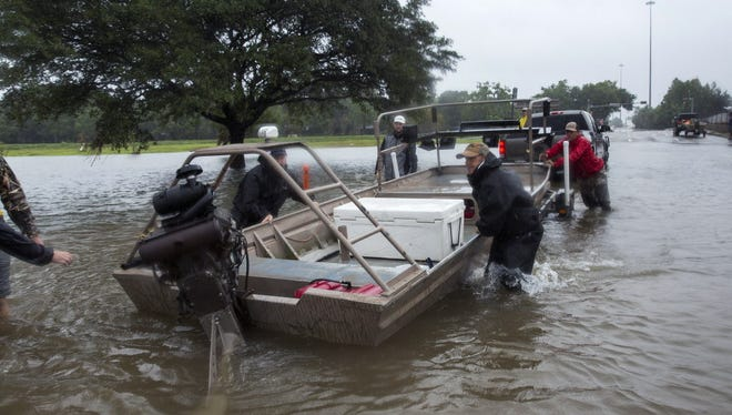 Volunteer search and rescuers from Passion Pursuit film production company launch their motor boat near Bray Bayou and Loop 610 to rescue flood victims in the Meyerland neighborhood  after Hurricane Harvey inundated the area Aug. 28, 2017, in Houston.
