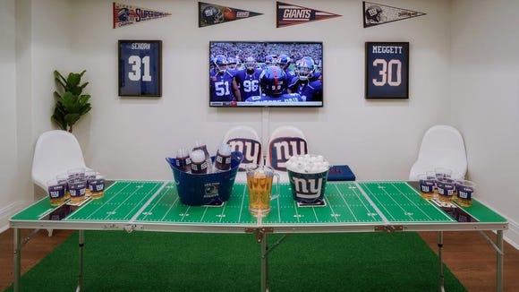 The NFL House has a recreation room.