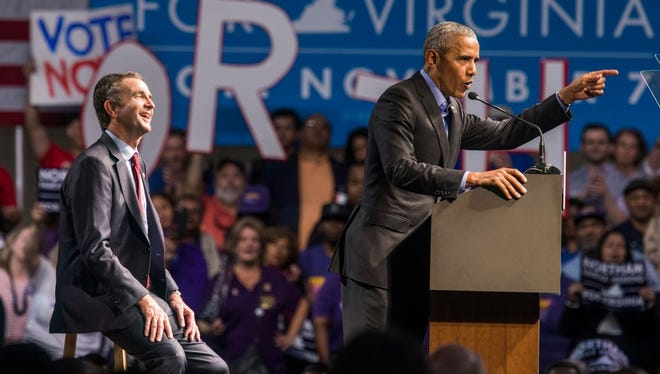 Former president Barack campaigns with Democrat Ralph Northam, candidate for Virginia governor, Richmond, Va., Oct. 19, 2017.