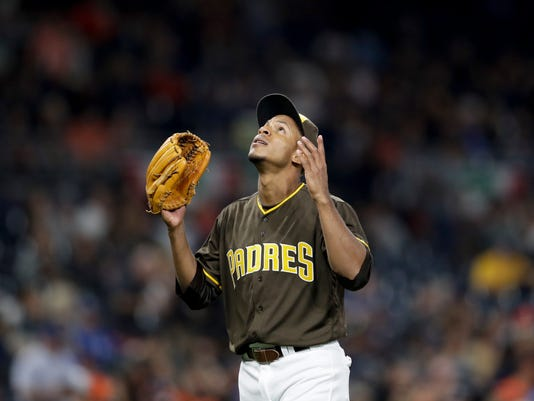 San Diego Padres relief pitcher Jose Torres reacts as he leaves the field during the seventh inning of a baseball game against the San Francisco Giants Friday, Sept. 23, 2016, in San Diego. (AP Photo/Gregory Bull)
