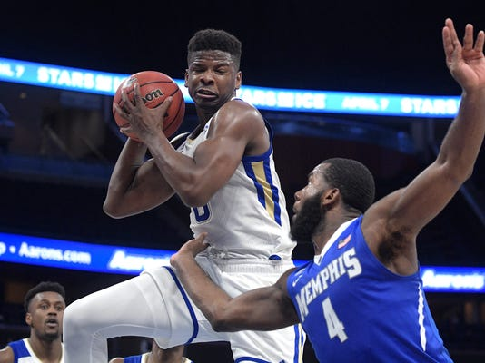 Tulsa forward Junior Etou (0) grabs a rebound in front of Memphis forward Raynere Thornton (4) during the second half of an NCAA college basketball quarterfinal game at the American Athletic Conference tournament Friday, March 9, 2018, in Orlando, Fla. Memphis won 67-64. (AP Photo/Phelan M. Ebenhack)