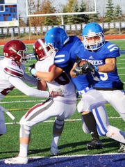 Catholic Central's Nicholas Capatina (with  ball) finds an opening in the Grandville defense.