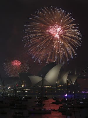 Fireworks explode over the Opera House and the Harbour Bridge during New Year's Eve celebrations in Sydney, Australia, Wednesday, Dec. 31, 2014.