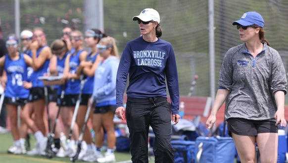 Bronxville head coach Sharon Robinson (center) roams