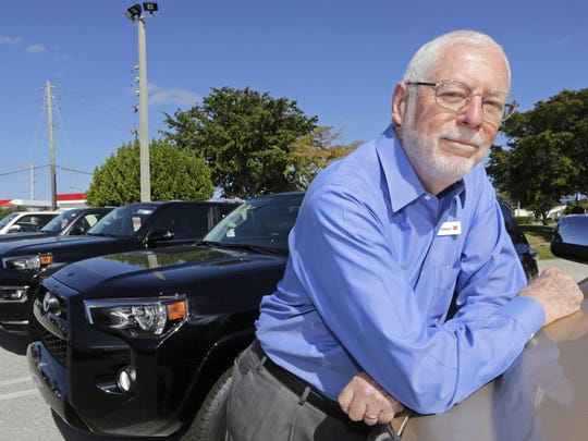 Earl Stewart, owner of a Toyota dealership, poses for a photo in the new SUV sales area at his business, in North Palm Beach, Fla.