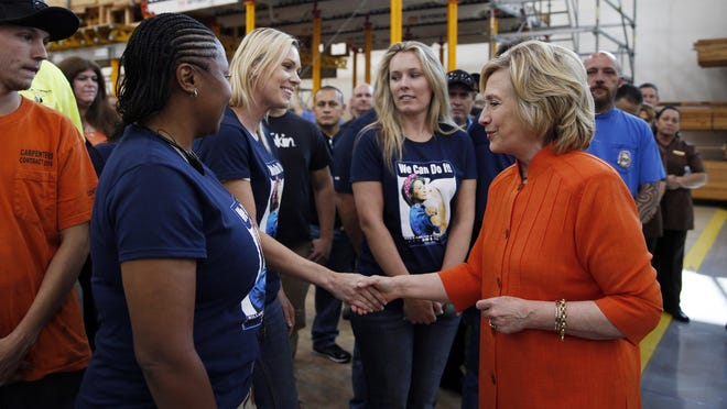 Democratic presidential candidate Hillary Rodham Clinton shakes hands while touring the Carpenters International Training Center Tuesday, in Las Vegas. The training center was one of several places Clinton visited in the Las Vegas area on Tuesday.