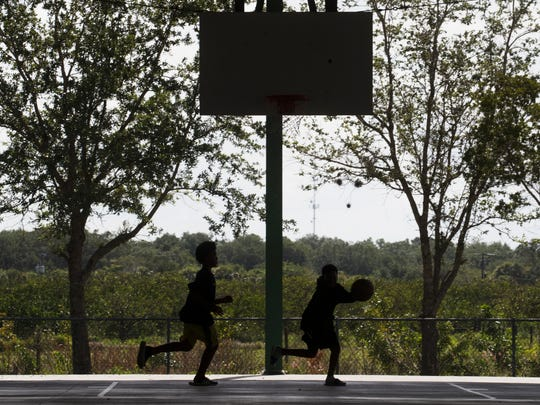 "Kids play basketball at the Charleston Park courts on Charleston Park Day in 2017. ""Residents worry the well water is detrimental to the health of their kids,"" said Tim Byrne, CEO of Aqua Consultants."