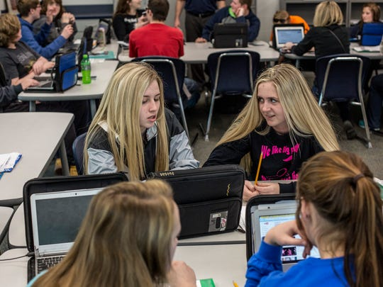 Senior Taylor Fogarty, 18, and Katie Basey, 17, work on an assignment during a personal finance class Tuesday, March 28, 2017 at Marysville High School. Marysville Public Schools has the highest graduation rate in the county at 94.8 percent.