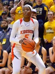 Detroit Edison's Rickea Jackson looks up for a shot