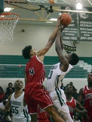 Peabody's Darius Smith (23) goes for 2 against Richwood