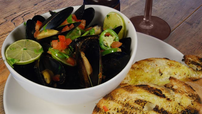 Kicked up mussels is one of the new menu options at the All American Sports Grill in Scottsdale.