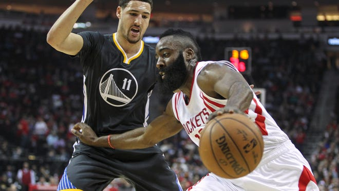 Rockets guard James Harden (13) controls the ball during the first quarter as Golden State Warriors guard Klay Thompson (11) defends at Toyota Center.