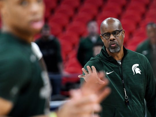 Michigan State's assistant coach Mike Garland calls
