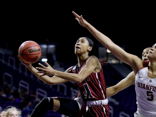 New Mexico State's Tamera William (21) gets past Stanford's Kaylee Johnson (5) to put up a shot during the first half of a first-round game in the NCAA women's college basketball tournament Saturday, March 18, 2017, in Manhattan, Kan. (AP Photo/Charlie Riedel)