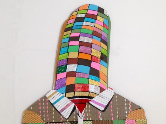 """Michael Stillion's collage """"Zipper,"""" created from paper, fabric and candy wrappers."""