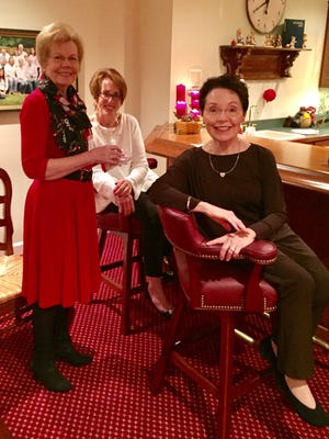 Holiday party -- Holley and Ed Brundick opened their home for this year's Vanderburgh Medical Alliance's Annual Holiday Party with guests bringing in a variety of holiday culinary delights. In the photo from left are Jolene Meyers, Mindy Tibbals and Sherie Hambidge.