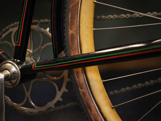 In this Feb. 17, 2015 photo shows a 1922 bicycle with wooden wheels and rubber tires that is on display in a new exhibit on bicycling in Wisconsin at the Wisconsin Historical Museum in Madison, Wis. The bike was made for and sold at Pritzlaff Hardware Store in Milwaukee.   (AP Photo/Wisconsin State Journal, Amber Arnold)