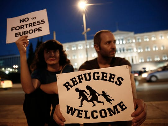 Thousands join 'refugees welcome' rallies as Hungary takes hard line